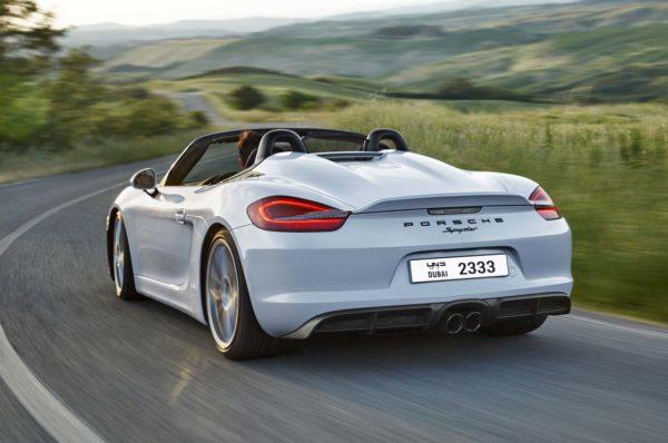 2016-Porsche-Boxster-Spyder-rear-three-quarter-in-motion-02